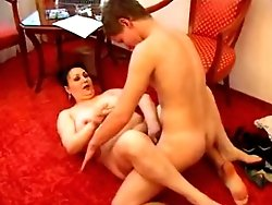 Sex crazed mature cougar can't get enough of hard young cock up her ass