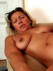 After fucking her mature mouth and her mature pussy he shoots his load on her sexy face