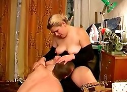 Young stud gets his dick sucked and fucked by a huge mature slut right in bed