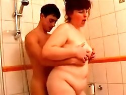 Hot busty MILF enjoys a wild bang with a youngster in the shower