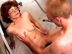 Young dick fucks an old whore right on the bathroom floor