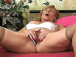 Seductive old woman grabs a huge violet dildo and starts licking its end then gets banged hard.