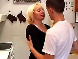 Mature pussy gets down and dirty with her son's friend right on the kitchen floor