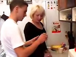 Hot blond MILF fucks a horny youngster right on the kitchen floor