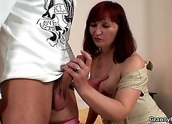 Redheaded granny turns him on with black stockings and he fucks her with great lust