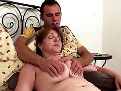 The awesome granny chick gets fucked missionary style and lets him cum on her hot box