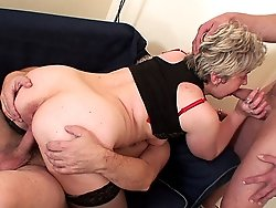 Granny is crazy for cock meat and they are giving her two dicks to play and have fun with